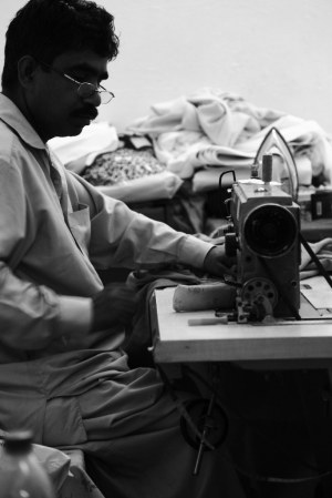 Tailor sewing Eid clothes late at night in Satwa, Dubai